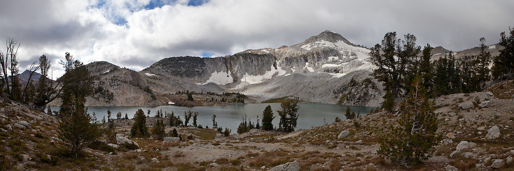 Snow covered cliffs tower above Glacier Lake, Eagle Cap Wilderness, Oregon