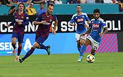 SSV Napoli midfielder Lorenzo Insigne dribbles the ball away from FC Barcelona midfielder Ivan Rakitic (4) during a La Liga-Serie A Cup soccer match, Wednesday, Aug. 7, 2019, in Miami Gardens, Fla. FC Barcelona beat Napoli 2-1 (Kim Hukari/Image of Sport)