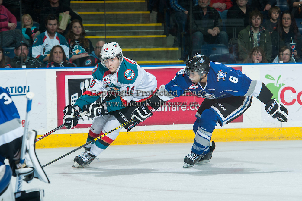 KELOWNA, CANADA - MARCH 11: Nick Merkley #10 of Kelowna Rockets is checked by Travis Brown #6 of Victoria Royals on March 11, 2015 at Prospera Place in Kelowna, British Columbia, Canada.  (Photo by Marissa Baecker/Shoot the Breeze)  *** Local Caption *** Nick Merkley; Travis Brown;