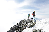 """Alpinists on the summit ridge.<br /> <br /> """"Matterhorn 150 years Cervino"""" - The year 2015 is the 150th Anniversary of the first ascent by Edward Whymper from the Swiss side (14th July) and by Jean Antoine Carrel from the Italian side on the 17th July 1865.<br /> <br /> On 17th July 2015 a friendship convention was signed by the members of Swiss, French, British and Italian climbing teams. A ceremony was held at the summit in honour of the mountain."""