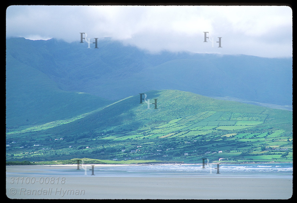 View of pastures and beach at base of Brandon Mountain, shrouded in clouds;(h) Dingle Peninsula. Ireland