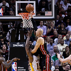 March 10, 2011; Miami, FL, USA; Miami Heat center Zydrunas Ilgauskas (11) swats the ball away from the goal during the fourth quarter against the Los Angeles Lakers at the American Airlines Arena. The Heat defeated the Lakers 94-88.   Mandatory Credit: Derick E. Hingle