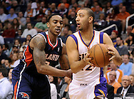 Mar. 1, 2013; Phoenix, AZ, USA; Phoenix Suns guard Kendall Marshall (12) handles the ball against the Atlanta Hawks guard Jeff Teague (0) in the second half at US Airways Center. The Suns defeated the Hawks 92-87. Mandatory Credit: Jennifer Stewart-USA TODAY Sports