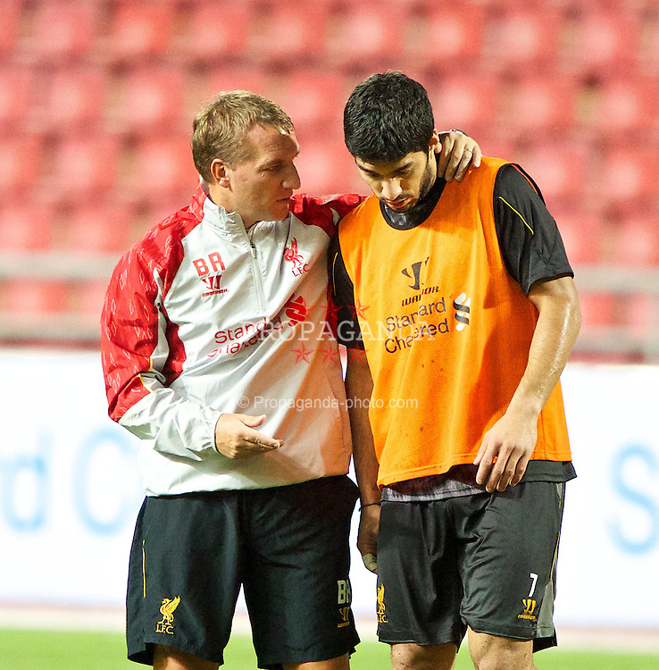 BANGKOK, THAILAND - Saturday, July 27, 2013: Liverpool's manager Brendan Rodgers and Luis Suarez during a training session at the Rajamangala National Stadium ahead of their preseason friendly match against Thailand. (Pic by David Rawcliffe/Propaganda)