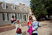 Williamsburg, VA - October 5, 2010: Visitors watch actor-interpretors during a performance in Colonial Williamsburg, Virginia on Tuesday, October 5, 2010.<br /> <br /> (Photo by Matt Eich/LUCEO for The Washington Post)