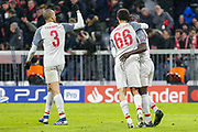 GOAL 1-3 Liverpool forward Sadio Mane (10) celebrates with Liverpool midfielder Fabinho (3) and Liverpool defender Trent Alexander-Arnold (66) after heading in Liverpool's third goal during the Champions League match between Bayern Munich and Liverpool at the Allianz Arena, Munich, Germany, on 13 March 2019.
