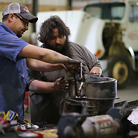 Thomas Wells | BUY at PHOTOS.DJOURNAL.COM<br /> Chris Hutcheson, left, and David Yarabrough work on repairing a air conditioner on a truck before summer arrives.