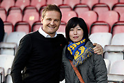 AFC Wimbledon manager Neal Ardley posing with fan during the EFL Sky Bet League 1 match between AFC Wimbledon and Peterborough United at the Cherry Red Records Stadium, Kingston, England on 12 November 2017. Photo by Matthew Redman.