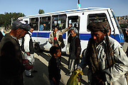 Afghans are busy at a bus stop near Bamiyan's new bazaar. The cliff where once stood the Western Buddha (55m - 'Male') is photographed after sunset in Bamiyan, Afghanistan, an area mostly populated by Hazaras. The Buddhas of Bamiyan were two 6th century monumental statues of standing Buddhas carved into the side of a cliff in the Bamiyan valley in the Hazarajat region of central Afghanistan, situated 230 km northwest of Kabul at an altitude of 2500 meters. The statues represented the classic blended style of Gandhara art. The main bodies were hewn directly from the sandstone cliffs, but details were modelled in mud mixed with straw, coated with stucco. Amid widespread international condemnation, the smaller statues (55 and 39 meters respectively) were intentionally dynamited and destroyed in 2001 by the Taliban because they believed them to be un-Islamic idols. Once a stopping point along the Silk Road between China and the Middle East, researchers think Bamiyan was the site of monasteries housing as many as 5,000 monks during its peak as a Buddhist centre in the 6th and 7th centuries. It is now a UNESCO Heritage Site since 2003. Archaeologists from various countries across the world have been engaged in preservation, general maintenance around the site and renovation. Professor Tarzi, a notable An Afghan-born archaeologist from France, and a teacher in Strasbourg University, has been searching for a legendary 300m Sleeping Buddha statue in various sites between the original standing ones, as documented in the old account of a renowned Chinese scholar, Xuanzang, visiting the area in the 7th century. Professor Tarzi worked on projects to restore the other Bamiyan Buddhas in the late 1970s and has spent most of his career researching the existence of the missing giant Buddha in the valley.