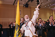 William Temple, center, dressed as a minuteman, cheers for Texas Governor Rick Perry  during day two of the Conservative Political Action Conference (CPAC) at the Gaylord National Resort & Convention Center in National Harbor, Md.