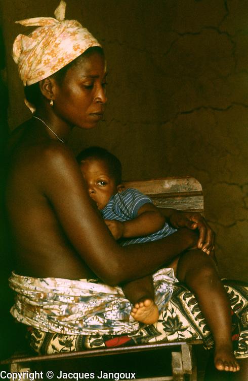Mother nursing baby, Kpelle tribe, Liberia.