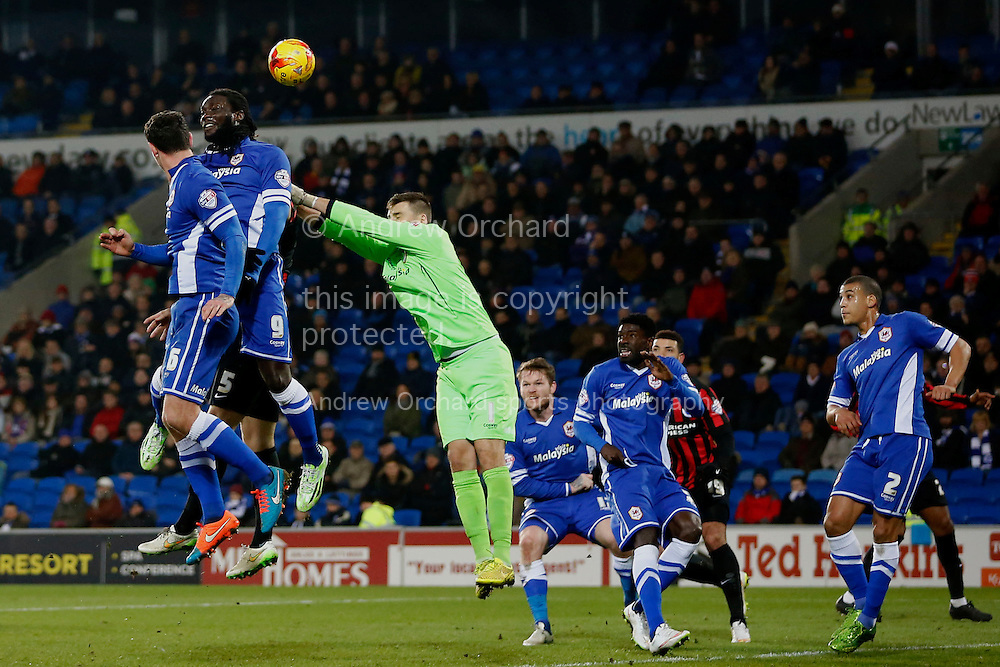 (L-R, leaping) Sean Morrison, Kenwyne Jones and David Marshall combine for Cardiff City to clear the danger.<br /> Skybet football league championship match, Cardiff City v Brighton &amp; Hove Albion at the Cardiff city Stadium in Cardiff, South Wales on Tuesday 10th Feb 2015.<br /> pic by Mark Hawkins, Andrew Orchard sports photography.