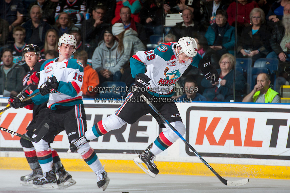 KELOWNA, CANADA - MARCH 1: Nolan Foote #29 of the Kelowna Rockets gets tripped up during first period against the Prince George Cougars on MARCH 1, 2017 at Prospera Place in Kelowna, British Columbia, Canada.  (Photo by Marissa Baecker/Shoot the Breeze)  *** Local Caption ***