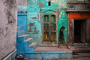 Narrow lanes of old Varanasi and brightly painted homes.