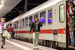 13.09.2015, Hauptbahnhof Salzburg, AUT, Fluechtlinge am Hauptbahnhof Salzburg auf ihrer Reise nach Deutschland, im Bild ein Dolmetscher mit einem Megaphon gibt anweisungen an die Flüchtlinge weiter // a translator with a megaphone gives instructions to the refugees. According to reports thousands of refugees fleeing violence and persecution in their own countries continue to make their way toward the EU, just days before Euopean leaders are set to meet in Brussels to discuss a solution to the arrival of so many people, Main Train Station, Salzburg, Austria on 2015/09/13. EXPA Pictures © 2015, PhotoCredit: EXPA/ JFK