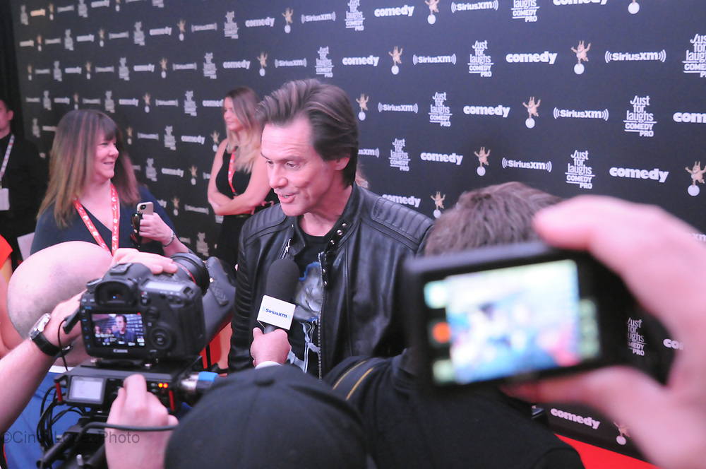 Actor/Comedian Jim Carrey surrounded by cameras on the red carpet in Montreal as he was being honored with the Generation Award presented by the Just For Laughs comedy festival. July 2017. (Cult MTL)