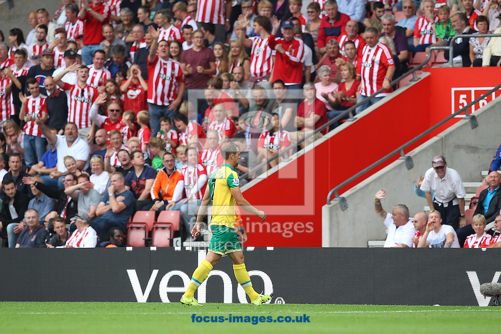 Steven Whittaker of Norwich leaves the pitch after getting a 2nd yellow card from Referee Jonathan Moss during the Barclays Premier League match at the St Mary's Stadium, Southampton<br /> Picture by Paul Chesterton/Focus Images Ltd +44 7904 640267<br /> 30/08/2015