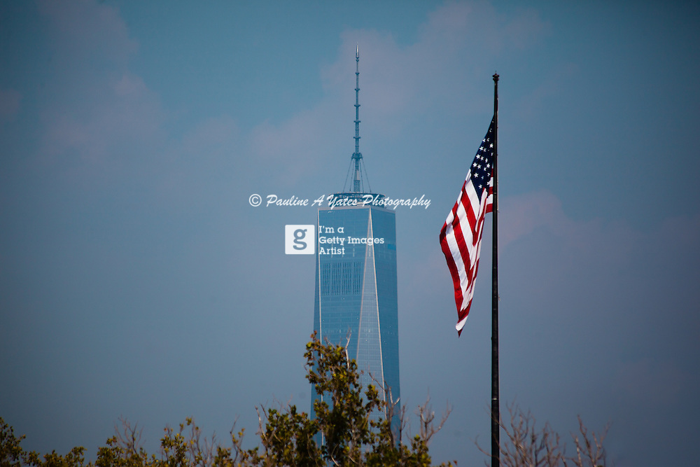 The World Trade Centre post 9/11 2001. The New world Trade building, Freedom Tower, stands high above the skyline with the Stars &amp; Stripes flying in the breeze<br />