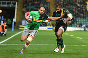 Harlequins wing Travis Ismaiel (14) holds off Northampton Saints wing Taquele Naiyaravoro (11) during the Gallagher Premiership Rugby match between Northampton Saints and Harlequins at Franklins Gardens, Northampton, United Kingdom on 1 November 2019.