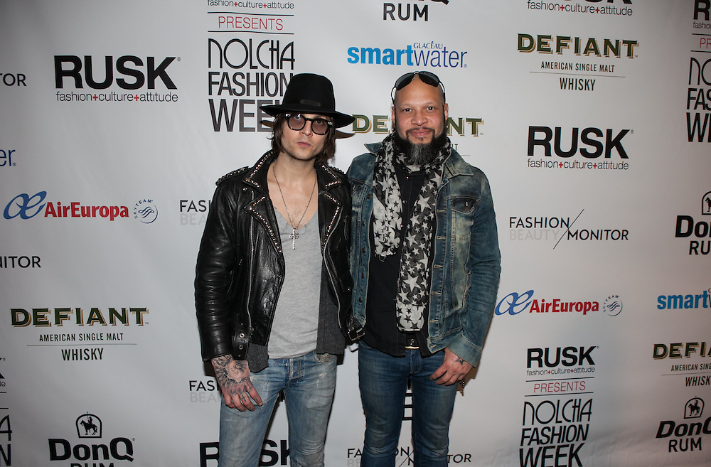 Fashion designer Christian Benner and Guns N' Roses drummer Frank Ferrer at Nolcha Fashion Week New York Fall-Winter 2014. Nolcha Fashion Week New York is a leading award winning event, held during New York Fashion Week, for independent fashion designers to showcase their collections to a global audience of press, retailers, stylists and industry influencers. Over the past six years Nolcha Fashion Week: New York has established itself as a platform of discovery promoting innovative fashion designers through runway shows and exhibition. Nolcha Fashion Week: New York has built an acclaimed reputation as a hot incubator of new fashion design talent and is officially listed by New York City Economic Development Corporation; offering a range of cost effective options to increase designers recognition and develop their business. (Photo: www.JeffreyHolmes.com)