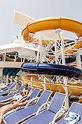 Royal Caribbean, Harmony of the Seas, Stretching the length of the ship, the Pool and Sports Zone is an ample playground for guests of all ages, featuring four unique types of pools, two FlowRider surf simulators, a zip line, amazing views of Boardwalk and Central Park below, plus the introduction of a trio of water slides as well as the Ultimate Abyss. plus bars and afternoon lice concerts The Perfect Storm – spiraling five decks above the landscaped, open-air Central Park in the center of the ship, waterslides Cyclone, Typhoon and Supercell come together as The Perfect Storm. Guests can challenge each other and race to the finish line with  Cyclone and Typhoon, which twist and turn down three decks, while sliders in Supercell will be swirled around its unique champagne bowl before descending into a big splash finale.