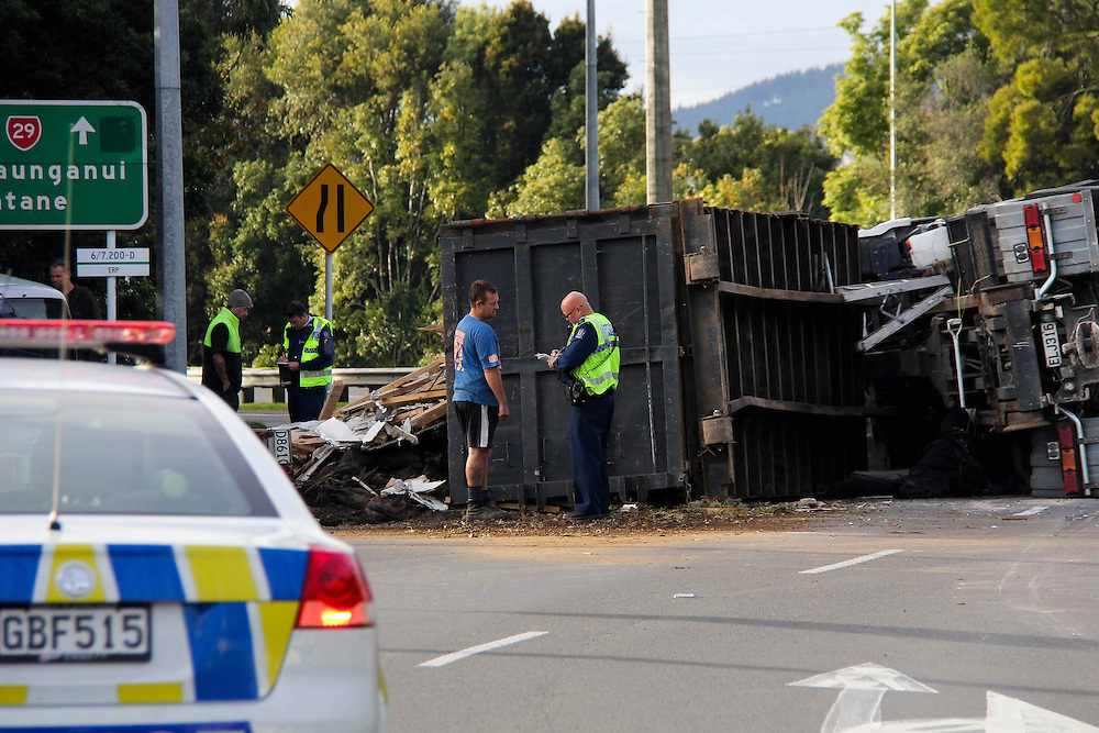 A rubbish truck carrying demolition material olled loosing  its load and blocking state highway 29, Maungatapu, Tauranga, New Zealand, Saturday,  July 20, 2013. Credit: SNPA / Cameron Avery