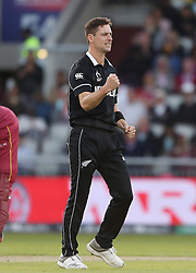 New Zealand's Matt Henry celebrates taking the wicket of West Indies Kemar Roach with Martin Guptill during the ICC Cricket World Cup group stage match at Old Trafford, Manchester.