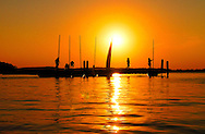 The sun sets over Lake Mendota near the University of Wisconsin campus in Madison, Wisconsin.