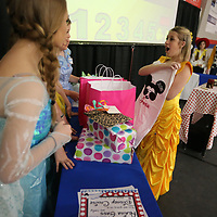 Alaina Gass, 14, shows one of the gifts she recieved to go along with her Disney Cruise she recieved from Make-A-Wish Wednesday at TCPS.