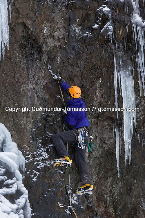 """Róbert Halldórsson on the first ascent of the ice climb """" Krókodílamaðurinn"""" M6, 30m, at Breiðdalur. East Iceland."""