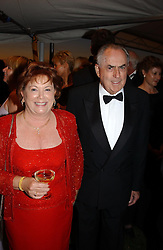 Left & centre, SIR JACK & LADY BRABHAM at the 2004 Goodwood Revival ball this year theme was a Venetian Masked Ball, held at Goodwood Motor Racing circuit, West Sussex on 4t September 2004.