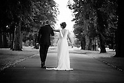 Bride & Groom walk up the Driveway of Beeston Fields Golf Club
