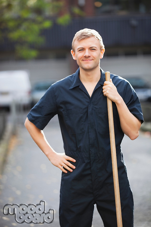 Portrait of young male street sweeper