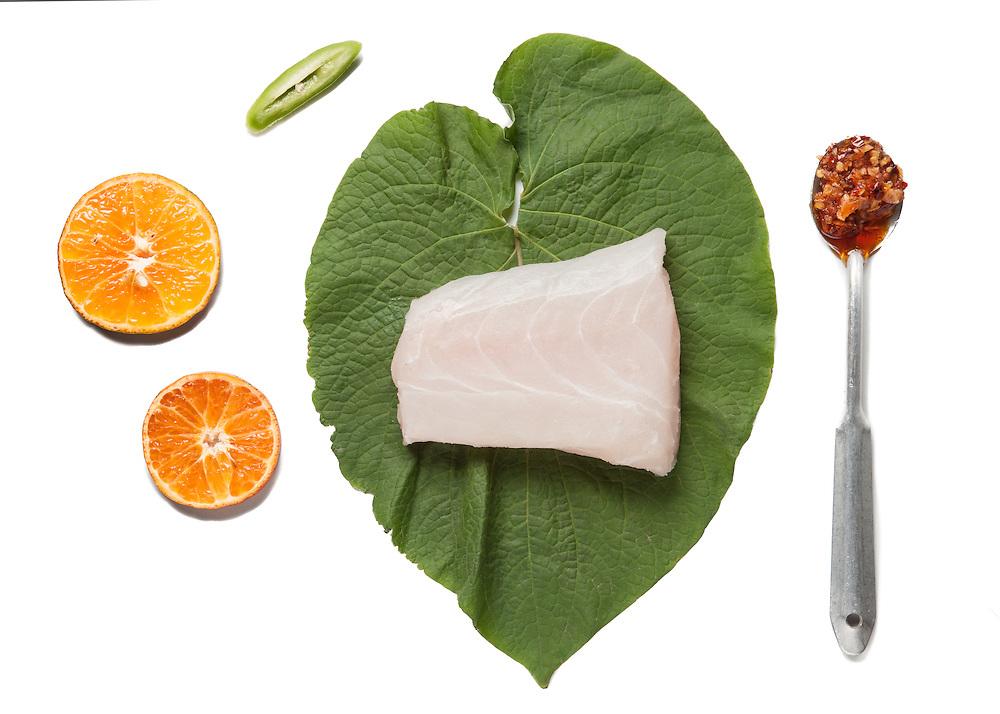Ingredients:<br /> <br /> 4 fish fillets<br /> 8 Hoja Santa Leaves.<br /> 2 green fresh chiles<br /> 1 Tangerine or Orange.<br /> 4 garlic cloves