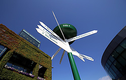 Signs showing the directions to various points within the grounds on day two of the Wimbledon Championships at the All England Lawn Tennis and Croquet Club, Wimbledon