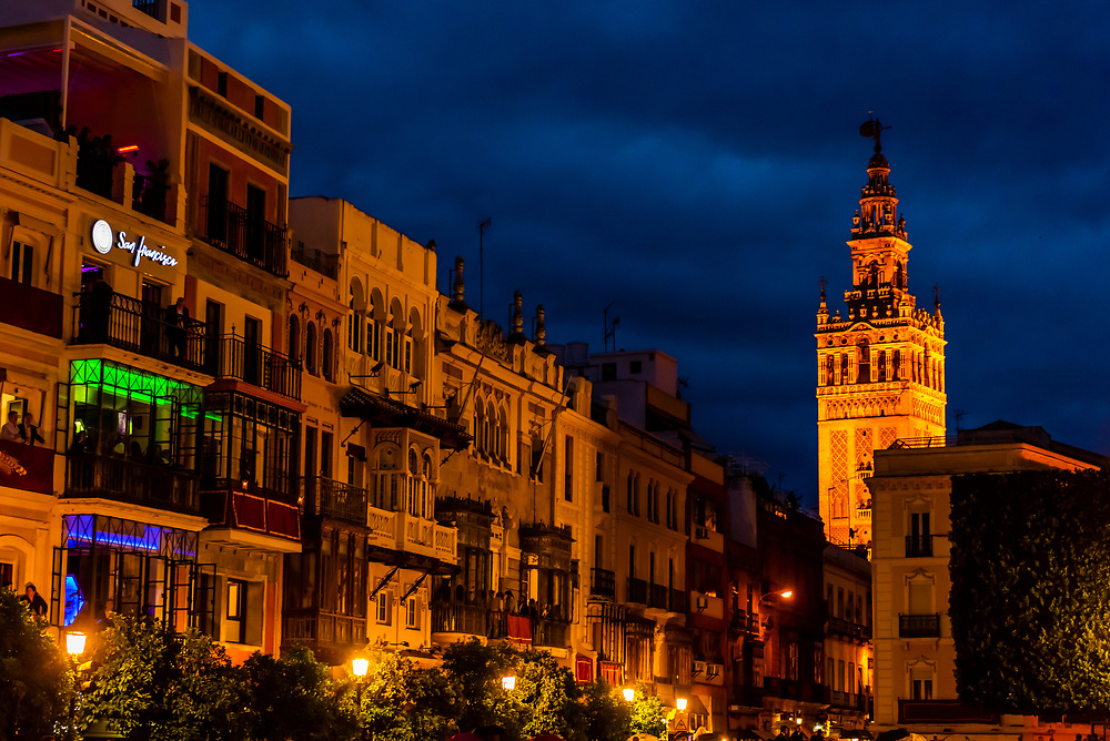 Plaza de San Francisco, lined with Maltese balconies (closed balconies) with the Giralda Tower in background on far right, Seville, Andalusia, Spain.