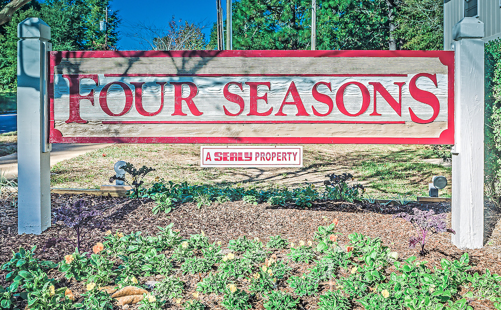 A entrance sign stands outside Four Seasons apartments, Nov. 24, 2015, in Mobile, Alabama. The apartment complex, managed by Sealy Management Co., is located on East Drive. (Photo by Carmen K. Sisson/Cloudybright)