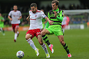Accrington Stanley's Séamus Conneely(28) and Forest Green Rovers Christian Doidge(9) during the EFL Sky Bet League 2 match between Forest Green Rovers and Accrington Stanley at the New Lawn, Forest Green, United Kingdom on 30 September 2017. Photo by Shane Healey.