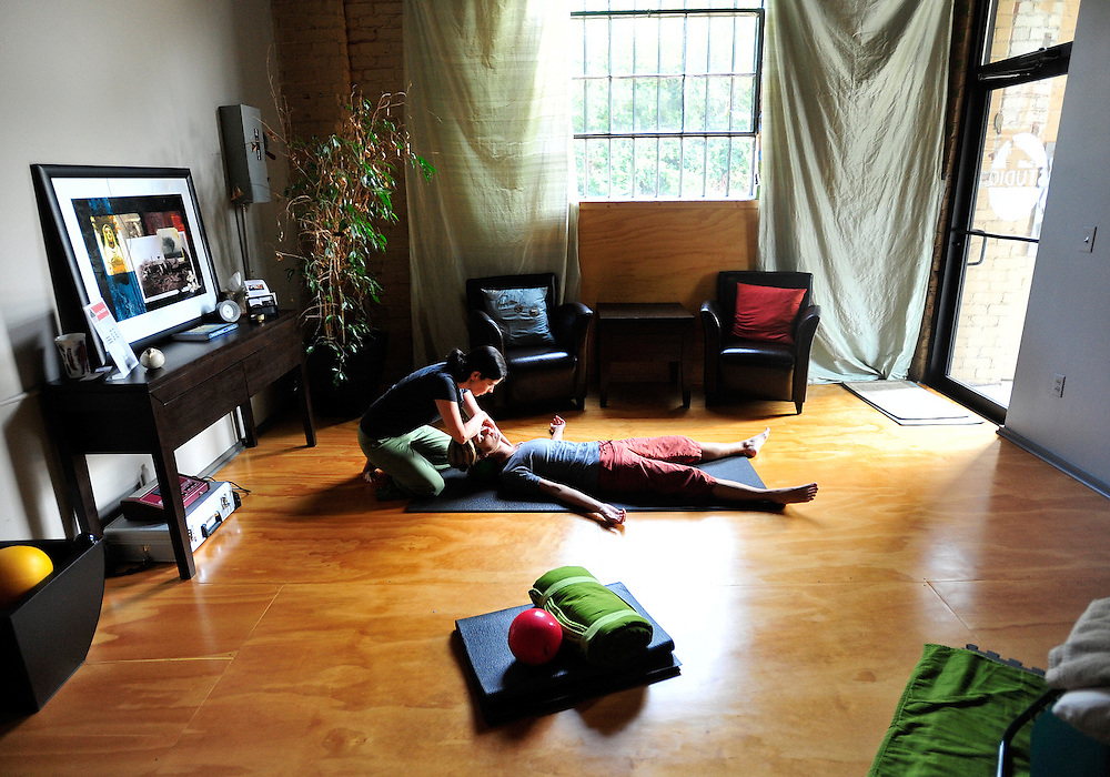 Lauren O'Grady, left, works with Daniele Statiras during a  yamuna body rolling session at Studio in Athens on Friday, Aug. 13, 2010 in Athens, Ga. .