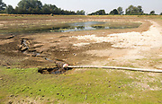 27 July 2017 Low water level in farm irrigation lake after long summer drought, Sutton, Suffolk England,UK