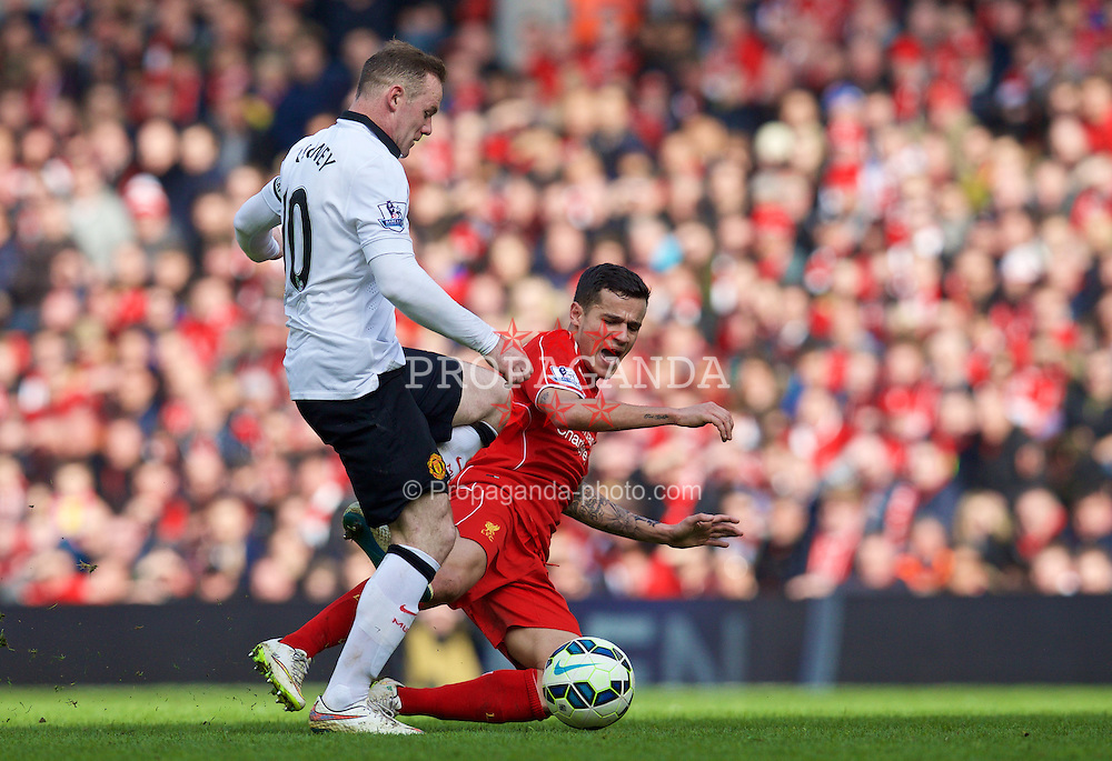 LIVERPOOL, ENGLAND - Sunday, March 22, 2015: Liverpool's Philippe Coutinho Correia is fouled by Manchester United's Wayne Rooney during the Premier League match at Anfield. (Pic by David Rawcliffe/Propaganda)