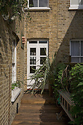 Garden terrace from a contemporary refurbishment of a Victorian terrace house at 74 Ulverscroft Road, East Dulwich, London, England. Designed by Jo Houchell & architect Oliver Houchell, 2008