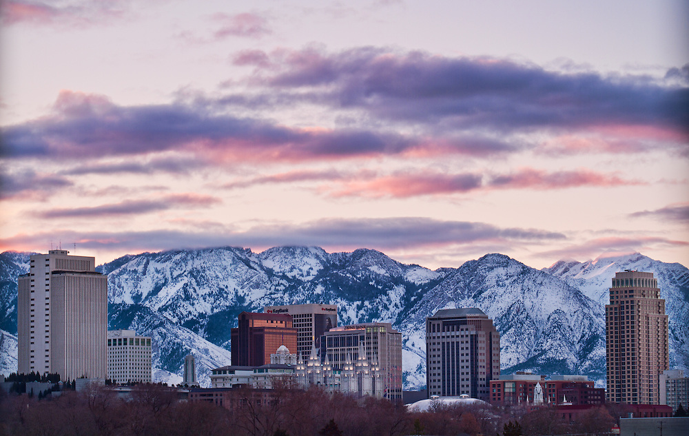 The Salt Lake City, Utah skyline in the early morning light of a Winter sunrise.