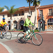 Couple riding a bicycle on State street. Santa Barbara, California. USA.