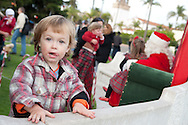 Sonny Wiczynski, 2, waits to meet Santa after the La Jolla Christmas Parade.