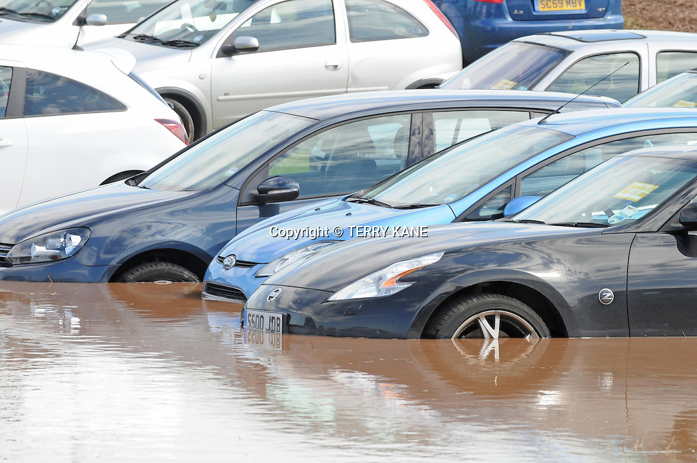 DARESBURY, UK:.Cars under water in the car park at Creamfields festival closed early by extreme weather  on Sunday, 26th August 2012..PHOTO BY TERRY KANE.+44 (0)7974 921 220.www.eyewitnessimages.co.uk