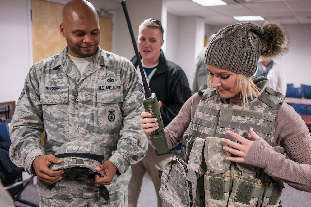 Prince George's County, MD - December  13, 2016:  WWE on air personality Renee Young puts on military jacket and helmet during Tribute to the Troops Day at the Joint Base Andrews in Prince George's County, Maryland.  WWE Superstars will spend time with members of all five branches of the military.  WWE began Tribute to the Troops in 2003 as a way to honor our servicemen and women and their families.   (Greg Kahn for ESPN)