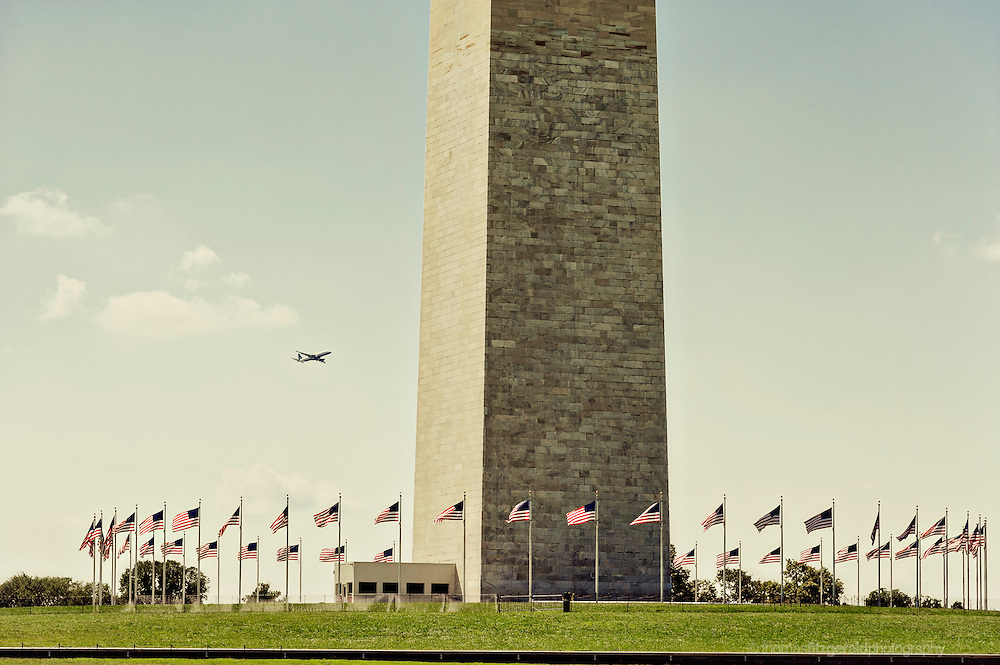 A Plane Takes off and passes behind the Washington Monument, Washington DC