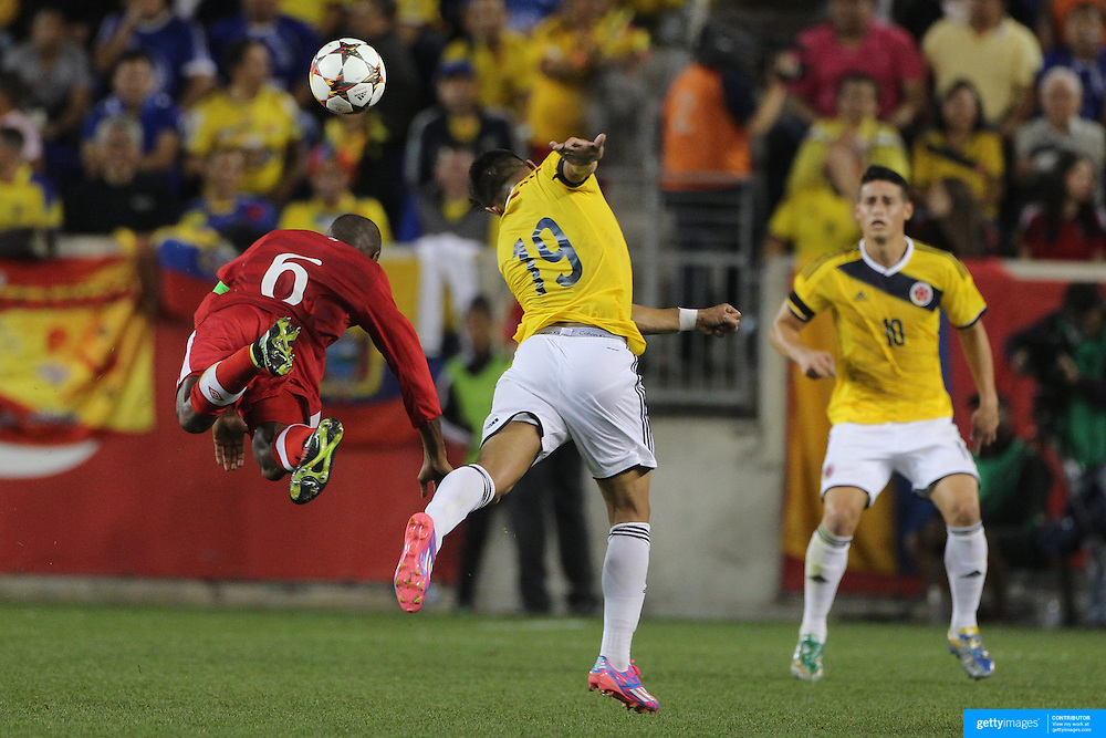 Julián De Guzman, (left), Canada and Teofilo Gutierrez, Colombia, challenge for the ball during the Columbia Vs Canada friendly international football match at Red Bull Arena, Harrison, New Jersey. USA. 14th October 2014. Photo Tim Clayton