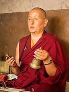05 AUGUST 2015 - KATHMANDU, NEPAL:  A Nepalese Buddhist monk chants during a funeral and cremation in Kathmandu.   PHOTO BY JACK KURTZ